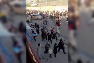 Crowds run from Taliban fire an hour before blasts